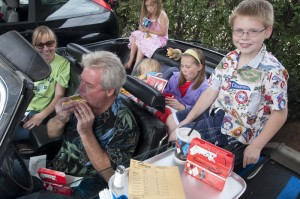 This family, in their classic El Dorado, is enjoying a Sunday at Superdawg.