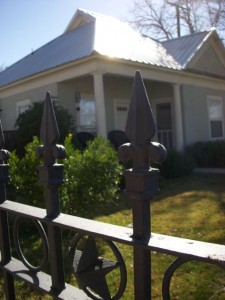 A pretty, habited house (see Texas star detail on fence).