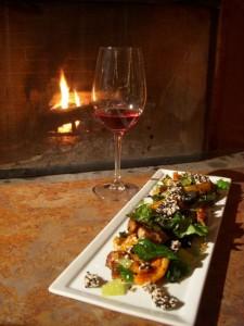 Pork belly and kabocha-squash salad (aka the Roadfoodie menu) accompanied by a glass of local rose.
